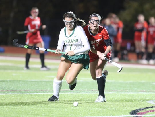Lakeland junior Keirra Ettere (in white) goes on the offensive vs. Somers in the Section 1 Class B final Nov. 2, 2019. The Hornets won 4-0.