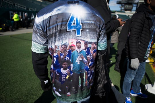 Trey Haynes shows off his custom shirt memorializing his brother Troy Haynes Sunday at Lincoln Financial Field. The Philadelphia Eagles staff and kicker Jake Elliot surprised the family with the photos of Troy's last visit to see the Eagles before his passing in September and a football after inviting them to watch the Eagles take on the Chicago Bears Sunday.