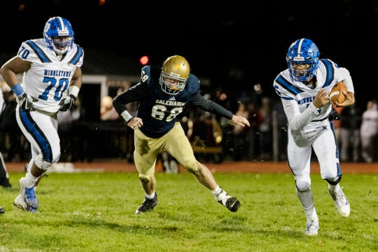 (5) Braden Davis on the run. Middletown outlasts Salesianum 28-27 at Brandywine High School stadium.