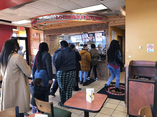 A line forms in the lobby of a Wilmington Popeyes.