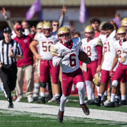 Midwestern State junior Bryce Martinez races down the sidelines against Tarleton State on Saturday, Nov. 2, 2019.