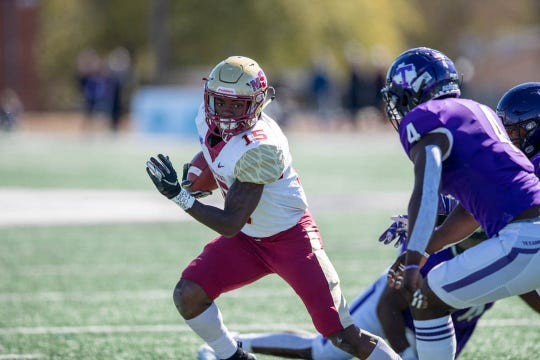 Midwestern State sophomore running back Lazarus Fisher tries to get around Tarleton State junior linebacker Ronnell Wilson on Saturday, Nov. 2, 2019.