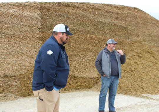 Corey, right, and Clint Hodorff talk about new the feeding set up at their Eden farm.
