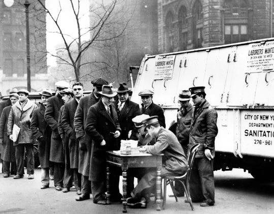 Men line up in front of City Hall to apply for jobs cleaning away snow in New York City on Jan. 3, 1934, around the height of the Great Depression.