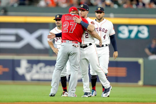 Jul 5, 2019; Houston, TX, USA; Los Angeles Angels center fielder Mike Trout (27) greets Houston Astros third baseman Alex Bregman (2) prior to the game at Minute Maid Park. Mandatory Credit: Erik Williams-USA TODAY Sports