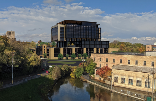 An architectural drawing shows the U.S. Venture headquarters atop a city parking ramp on Bluff Site 1 in downtown Appleton. Company President and CEO John Schmidt said the development is designed to be compatible with the nearby Historic Fox River Mills Apartments.