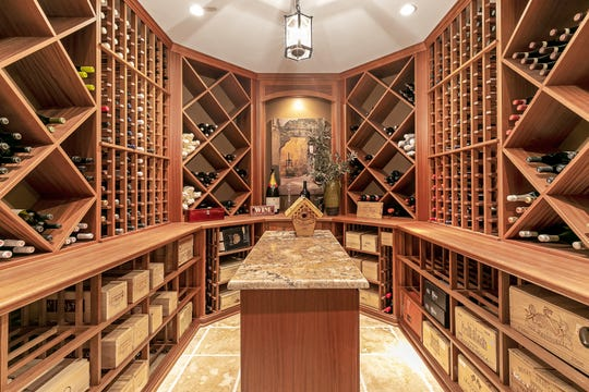 The home features a wine cellar a wet bar.