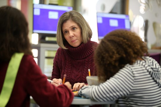 Christin Agee, owner of Shore I Can, a five-year-old Neptune-based provider of children's tutoring services in math and reading, holds a writing clinic at the Neptune Library in Neptune, NJ Monday, November 4, 2019.