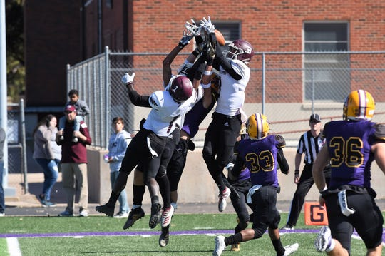 McMurry receivers Kevin Hurley (3) and Eriel Dorsey (1) go up for a Hail Mary pass at the end of the first half against Hardin-Simmons. Hurley and Dorsey are two of nine seniors playing their final home game Saturday against Louisiana College.