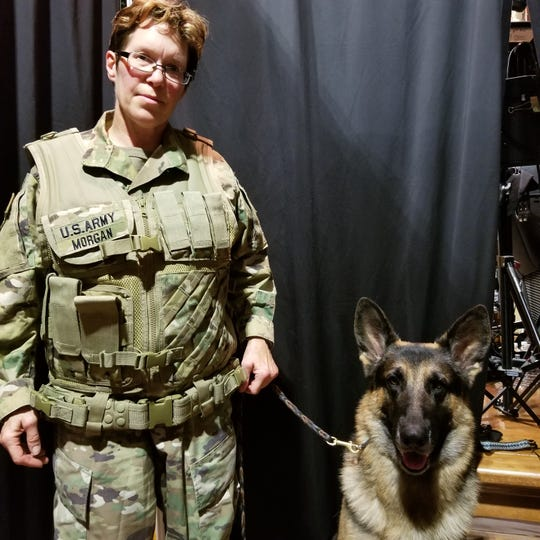 Endwell resident Mary Cummings stands beside her German shepherd, Ivan, on the set of Saturday Night Live.