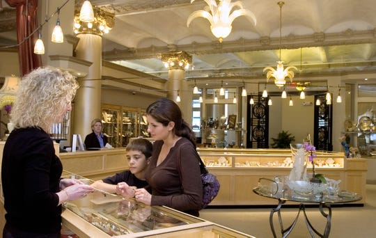 Amie Almy and her son Clayton, 9, of Johnson City look at jewelry in the new Goldsmith location with the help of store manager Kathy Allen in 2007.