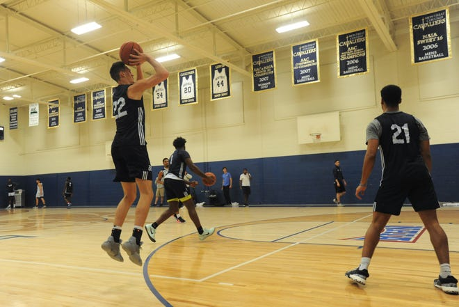 Montreat College senior Austin Butler puts up a three-point shot during practice. Butler scored a career-high 44 points while eclipsing the 1,000-point mark for his career in the Cavs' season opener against Alice Lloyd, Oct. 29.