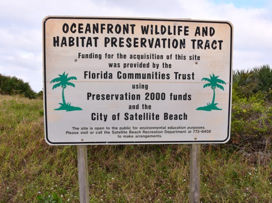 Signs surrounding Hightower Beach Park state the property is an oceanfront  wildlife and habitat preservation tract.