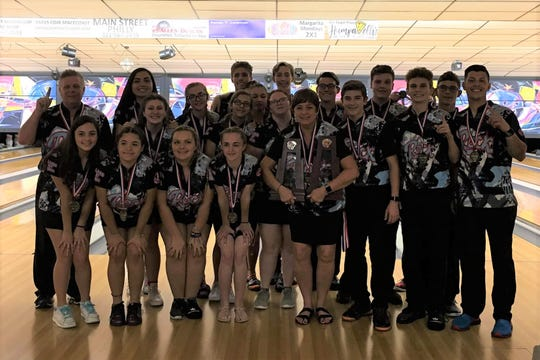 Rockledge boys and girls bowling teams and coaches pose with district trophies.