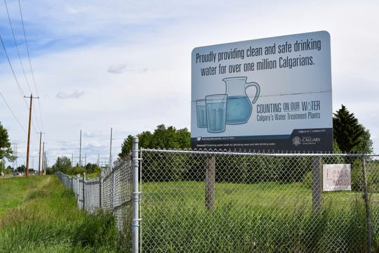 This July 2, 2019 photo shows a sign outside the Glenmore Water Treatment Plant in Calgary, Alberta, Canada. The plant sources its water from the Elbow River. Drinking water in Canada can become contaminated as it travels from treatment plants to taps by passing through lead pipes.