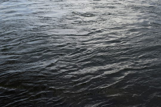 This June 22, 2019 photo shows ripples on the St. Lawrence River which supplies water to both of Montreal, Quebec, Canada's, two water treatment plants. Mayor Valerie Plante vowed to test 100,000 homes for lead and speed up replacement of lead-lined pipes immediately after journalists sent her an analysis of the city's internal data revealing high lead levels across the city.