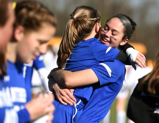 Thetford's Ellen Varacka and teammate Emma Colby celebrate their win over Vergennes for the Division III high school girls soccer championship on Saturday.