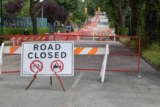 A section of East 12th Avenue is closed off while the City of Vancouver replaces a water main on July 14, 2019. According to the City, the existing water main is predicted to be over 100 years old, having been installed between 1906 and 1909. In Canada, where provinces -- not the federal government -- set water safety rules, the main source of lead in drinking water is antiquated pipes.