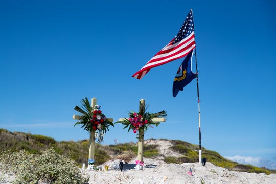 A makeshift memorial for James and Michelle Butler at mile marker 263 on Padre Island Beach was placed near where their bodies were found.