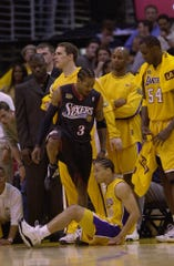 Allen Iverson steps over Tyronn Lue #10 of the Los Angeles Lakers in Game 1 of the NBA Finals.