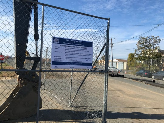 A sign and construction fence mark part of the area where water, sewer and road improvements are underway in North Camden.