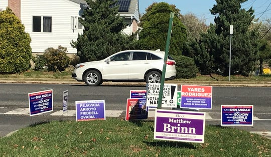 Candidates signs have sprouted on a traffic island at Chapel Avenue and Windsor Drive in Cherry Hill.