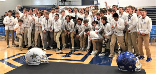 Michael Mayer celebrates with CovCath football teammates, November 4, 2019
