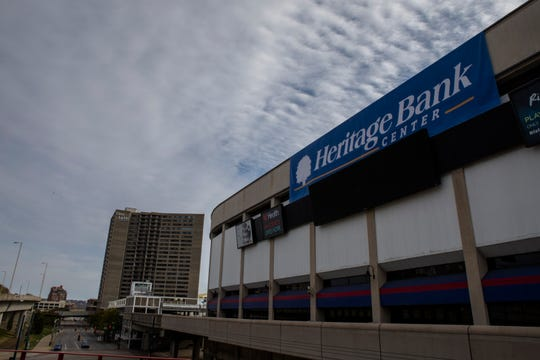 The Heritage Bank Center sign is hung at what was formerly U.S. Bank Arena in downtown Cincinnati on Monday, Nov. 4, 2019.