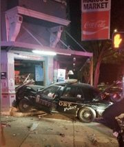 A Newport police cruiser crashed into a business early Monday, fire officials say.