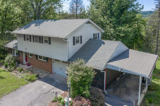 A brick-accented Colonial backing up to preserved acreage is sited on 0.66-acre of open, level property edged by a wooded perimeter and is for sale for$339,900.