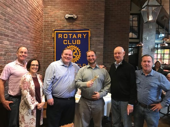 Congratulating the 2019 Rotary Club Golden Wrench winner Aaron Fragnito (center), are Dr. Bill Bonsall (l-r), Rotary Club President Liz Ensslin, last year's winner Blake Width, Esq, Event Chair Warren Rorden and Ray Kostyack, who are on the Golden Wrench Committee.