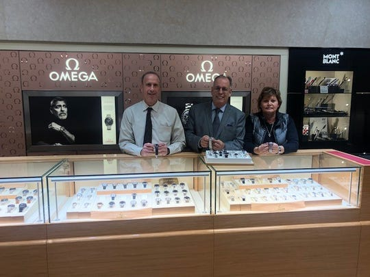"When it's time to ""fall back,"" Fords Jewelers gets ready, winding the watches back in the New Brunswick Avenue shop in Woodbridge. Here, Fords Jewelers Mitch Yellin,  Albert Dahl and Debbie Saparito are turning back some of the watches in the store."