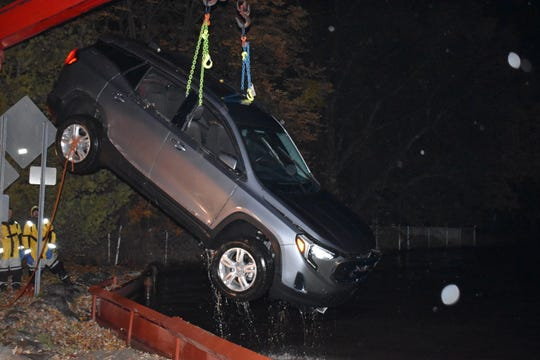 Workers pull the SUV from Lake St. Clair after rescuing the Chesterfield Township teen.