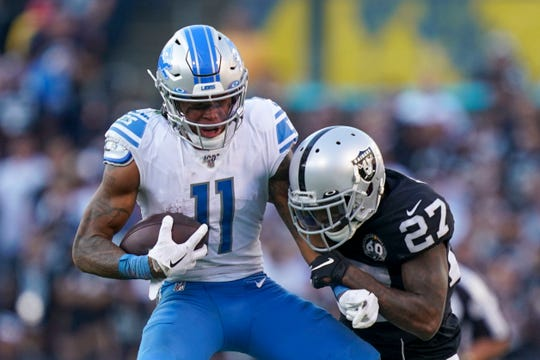 Detroit Lions receiver Marvin Jones Jr. is tackled by Oakland Raiders cornerback Trayvon Mullen during the fourth quarter at Oakland Coliseum, Nov. 3, 2019.