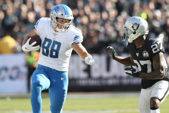 Detroit Lions tight end T.J. Hockenson runs after a catch against Oakland Raiders cornerback Trayvon Mullen in the second quarter at Oakland Coliseum, Nov. 3, 2019.