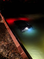 The SUV sinks in Lake St. Clair.