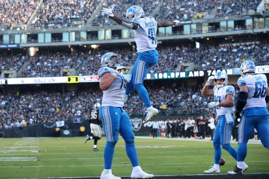Detroit Lions running back J.D. McKissic celebrates with guard Kenny Wiggins after catching a touchdown pass against the Oakland Raiders in the fourth quarter at Oakland Coliseum, Nov. 3, 2019.