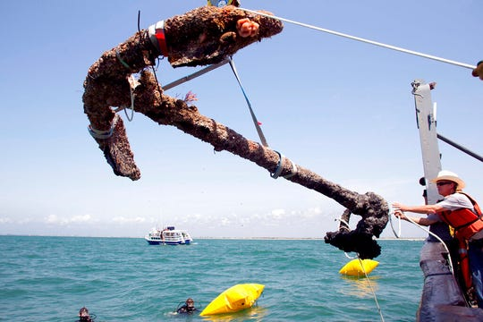 In this May 27, 2011 file photo, a 3,000 pound anchor from what is believed to be the wreck of the pirate Blackbeard's flagship, the Queen Anne's Revenge, is recovered from the ocean where it has been since 1718, in Beaufort Inlet, in Carteret County N.C.