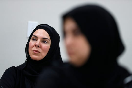 Yasmine Eastman, left, and Amal Faraj listen during a class at the Al-Hujjah Islamic Seminary in Dearborn Heights, Mich., Oct. 9, 2019.