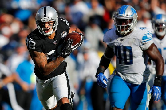 Raiders wide receiver Marcell Ateman (88) runs in front of Lions linebacker Jarrad Davis (40) during the second half on Sunday.
