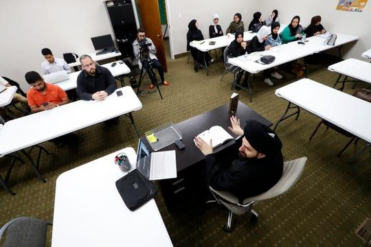 Imam Sayed Mohammad Baqer Al-Qazwini speaks during a class at the Al-Hujjah Islamic Seminary in Dearborn Heights, Mich., Oct. 9, 2019.
