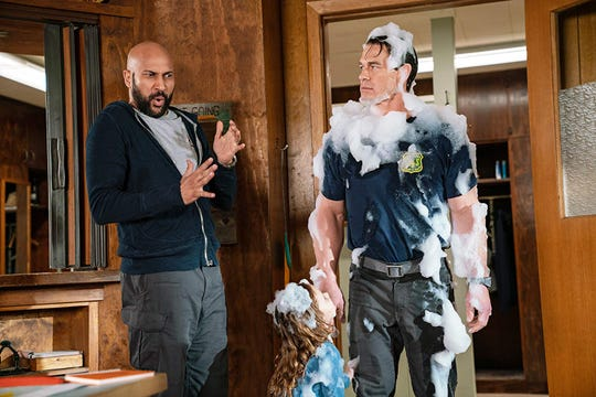 "Keegan-Michael Key, Finley Rose Slater and John Cena in ""Playing with Fire."""