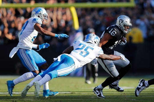 Raiders wide receiver Tyrell Williams (16) runs against Lions defensive back Will Harris (25) during the second half on Sunday.