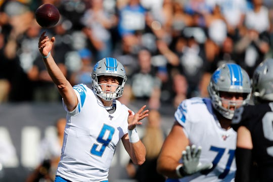 Lions quarterback Matthew Stafford (9) threw for 406 yards and three TDs but it wasn't enough on Sunday.