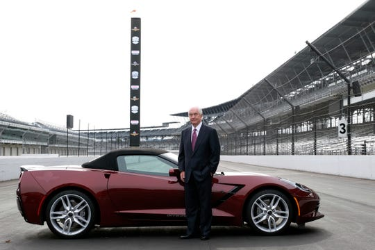 Roger Penske poses for a photo on the front straightaway of the Indianapolis Motor Speedway following a news conference Monday.