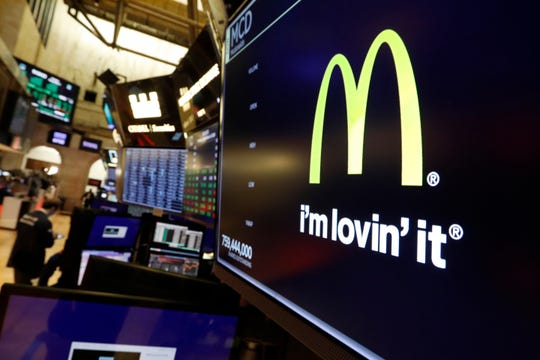 The logo for McDonald's appears above a trading post on the floor of the New York Stock Exchange, Monday, Nov. 4, 2019.