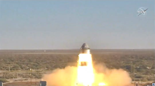 In this image made from a video provided by NASA Boeing tests the launch abort system of the Starliner capsule in White Sands Missile Range in N.M., on Monday, Nov. 4, 2019.