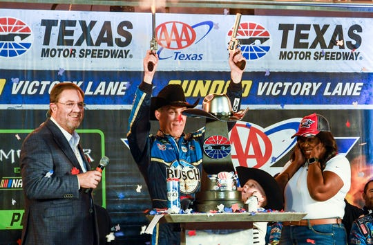 Kevin Harvick celebrates in Victory Lane after winning Sunday's NASCAR Cup Series  at Texas Motor Speedway.