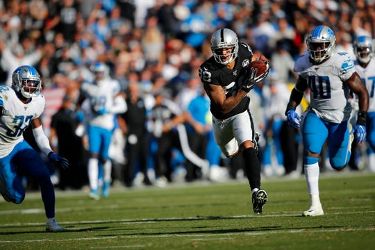 Oakland Raiders wide receiver Marcell Ateman runs in front of Detroit Lions linebacker Jarrad Davis during the second half.