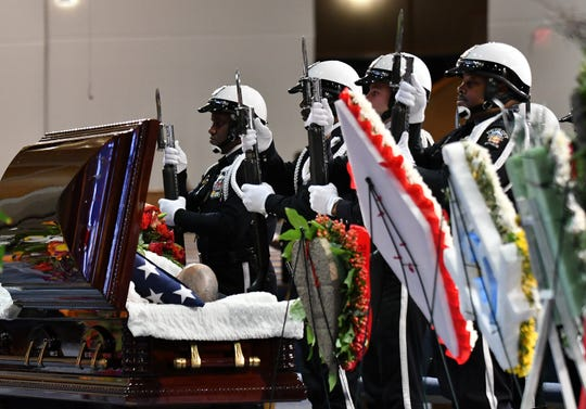 The Detroit police color guard pay their respects before the family hour at the funeral for former Congressman John Conyers Jr.  He represented Detroit in the U.S. House for 53 years, becoming the longest serving African American member of Congress in U.S. history.